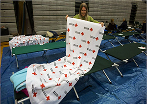 A Red Cross volunteer readies a shelter following Hurricane Sandy. (Photo: Red Cross)
